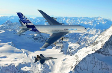 The A380 in flight with fighter jet at wing