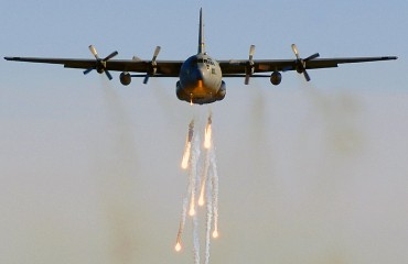 Lockheed C-130E dropping flares