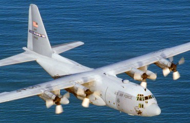 Lockheed C-130 Hercules flying over water